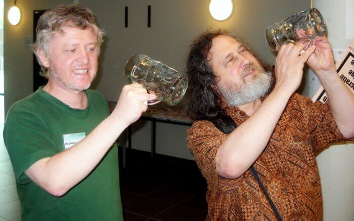 "Richard Stallman (right) illustrating his famous sentence ""free as in free speech not as in free beer"", with a beer glass. Brussels, RMLL, 9 July 2013"
