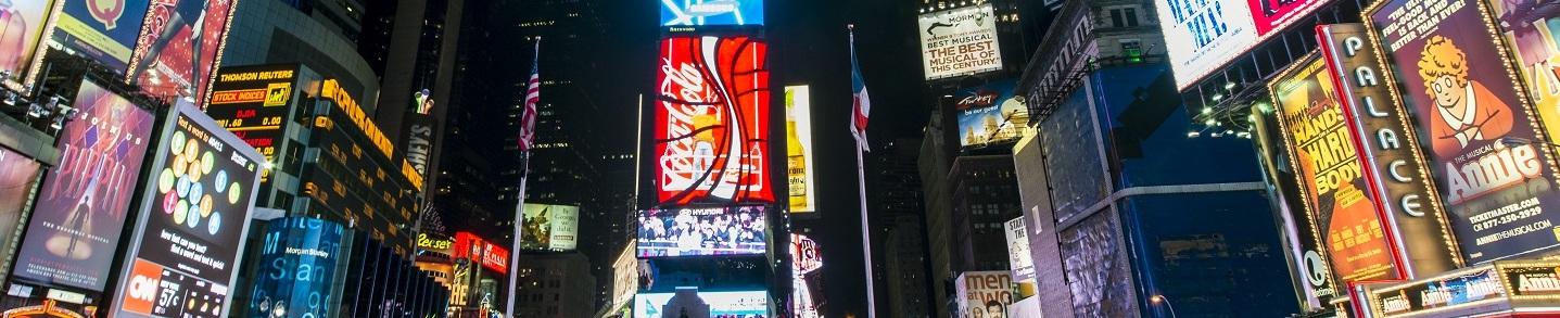 Manhattan banner Times Square at night. Image via Wikipedia by chensiyuan. CC BY-SA 3.0