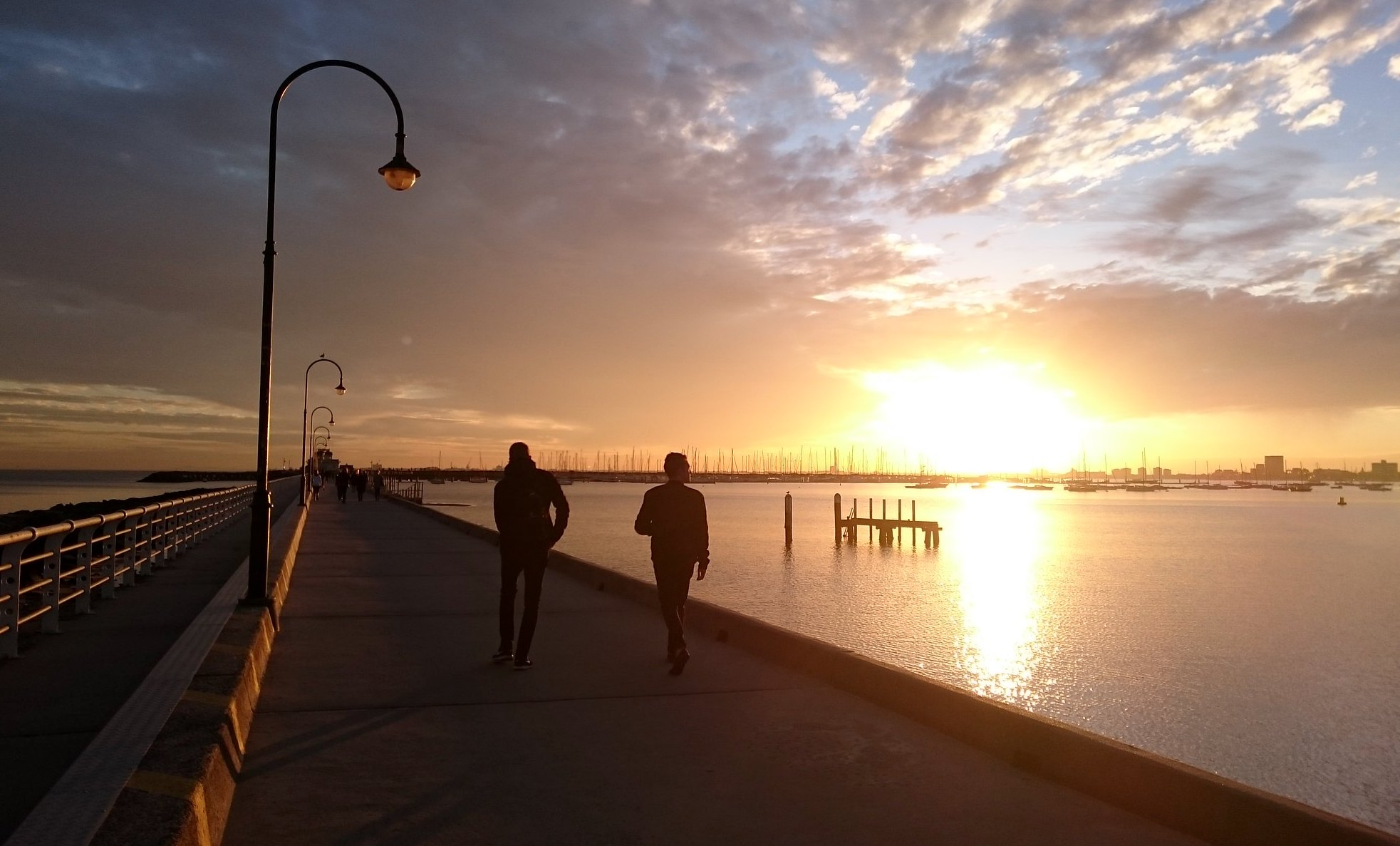 Sunset at St Kilda Breakwater, Image via Flickr by Ash Kyd. CC BY.
