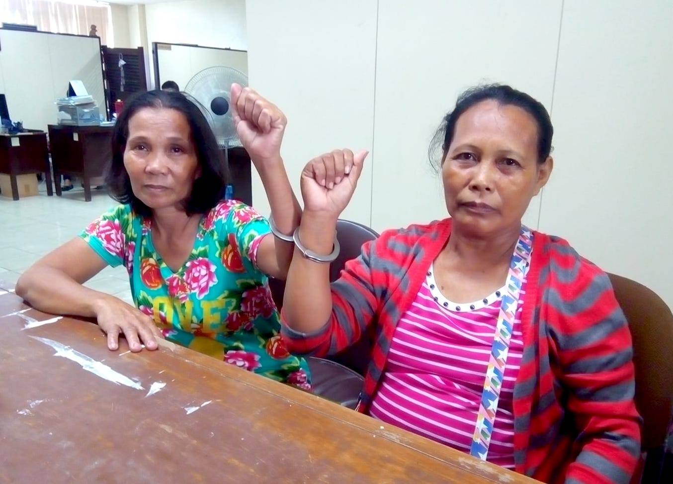 Imelda Pasinabo Sultan (50) and Ma. Lindy Perocho (53) insisted that the firearms and explosives found on top of paper files on the table were all planted by members of the police as commonly maneuvered to legitimize the arrest of activists who criticize the policies and programs of the Duterte Administration.